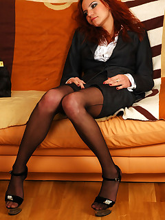 Office babe in fullfashioned black nylons smoking and reaming her asshole