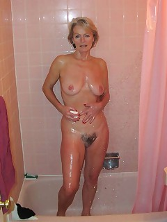 Sexy old bag in the shower Those titties look awesome all soaped up
