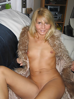 look at this sexy mature thing Love they way she poses in that fur coat very nice