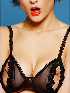 Gavina Head knows that bright red lipstick and dark hair are a terrific contrast Add to that the sexy black peekaboo bra and you have quite a look
