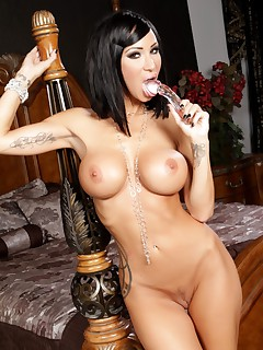 Sandee Westgate poses her smoking hot body around the bed pole Her nice round ass in the air her beautiful big boobs hanging and her sultry pussy spread with her toy