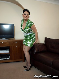 Cockhungry suburban wife Daniella in sexy green dress and fishnet stockings