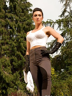Miss Hybrid wearing jodhpurs boots and gloves