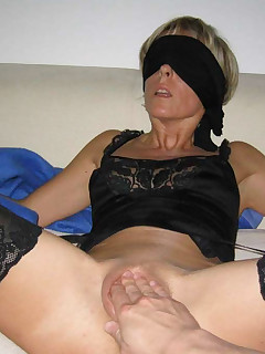 Blindfolded MILF in a wild sex party