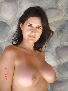 Busty brunette housewife posing naked outdoors