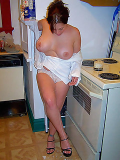 Busty housewife posing and showing off tits