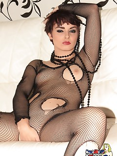 Portia V feels and looks sexy in just her crotchless fishnet bodysuit as she teases you on her couch