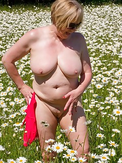 Hi Guys What Fantastic Weather we are Having I just cant get enough of the Sun and I just love to get out and about in the country We came across a field of Moon Daisys an ideal setting for this shoot in my Red BikiniSpeedybee  x x x