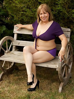 Hi Guys in the Garden again in my Purple Hotpants and short tie top but it was such a lovely day I just had to strip off and work on my all over tanSpeedybee  xxx