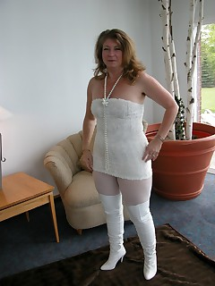 Devlynn shows a change of pace here with an all white Snow Princess look White furry dress white pantyhose paired with Thigh High white boots No pure white innocence here though Kisses Devlynn