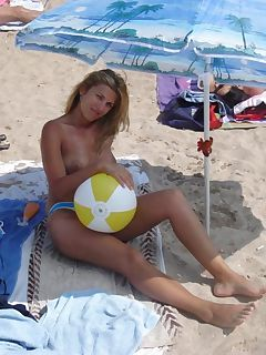 Hot picture gallery of a topless blonde housewife on vacation at the beach