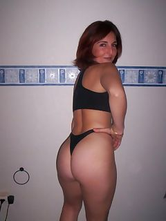 Hot photo gallery of a brunette wife showing her ass and shaved pussy