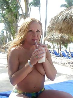 Picture collection of a naughty wife showing her tits at a beach