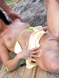 Tropical threesome with cocks on the beach for horny Simone