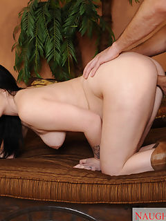 Busty brunette babe comes over to give neighbor a gift and a blowjob