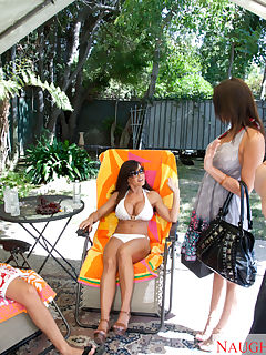 Two smokin hot brunettes share a big cock