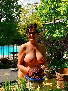 Pretty mature nudist doing some gardening