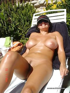 Sexy wife posing naked outdoors for her lover