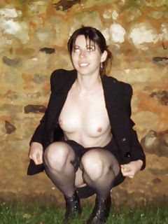 Sleazy MILF posing outdoors