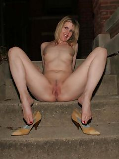 Naked MILF spreads outdoors