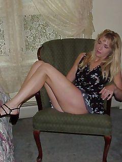 Black dressed blonde striptease