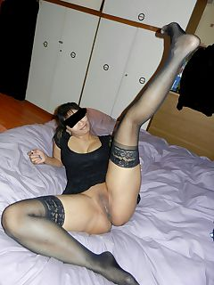 wife in black dress and stockings