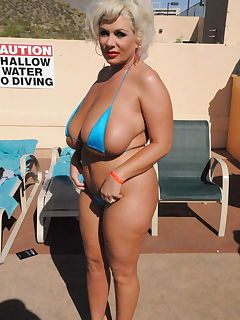 pre implants claudia marie poolside in a tiny blue bikini