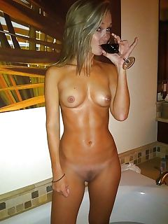 a glass of wine before her bath
