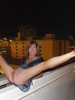 shaved flexible milf on balcony
