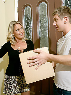 Blonde cougar takes advantage of her young neighbor in the bedroom